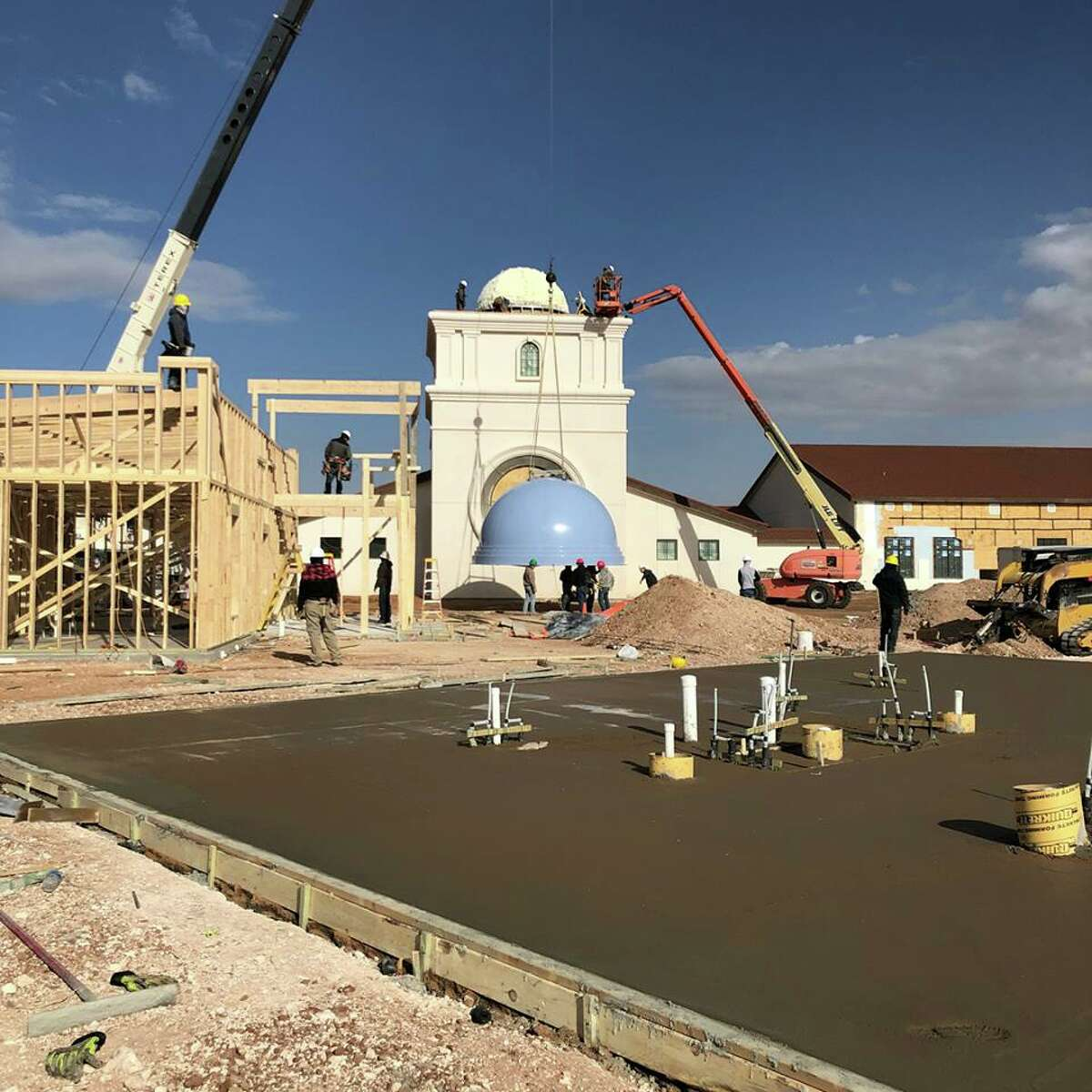 Workers on Thursday installed a blue dome and cupola on the top of the chapel at The Way Retreat Center on Todd Road. The nondenominational facility, which will host events such as spiritual and corporate retreats and weddings, is scheduled to open in April. Groundbreaking for The Way was in June 2016, but it is a project that was more than 10 years in the making, according to a previous Reporter-Telegram article. It is the culmination of planning and commitment on the parts of many people, especially Mike LaMonica, capital campaign manager; Brian Fralin, president of the nonprofit's board; and Andy Iverson, board vice president. For more information, visit thewayrc.com .