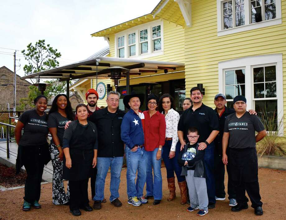 J.J. Moore, in cowboy hat, with his sister, Kim Winkelmayer, in red shirt, and the owners, chef and staff of The Ivy & James at Bellaire's Evelyn's Park. Photo: Dorothy Puch Lillig
