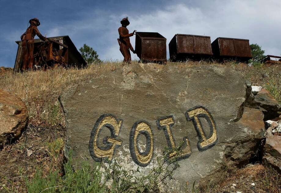 Figures depicting miners stand next to old ore carts outside the Sutter Gold Mine in Sutter Creek in 2008. Gold was discovered in the area 170 years ago, setting off a rush to find the precious metal that shaped California's future. Photo: Justin Sullivan, Getty Images