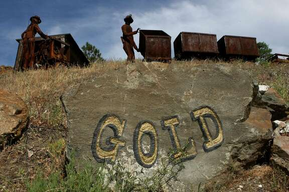SUTTER CREEK, CA - APRIL 28:  Figures depicting miners stand next to old ore carts outside of the Sutter Gold Mine April 28, 2008 in Sutter Creek, California. With gold trading over $900 per ounce, people are flocking to California's gold country in search of gold. Companies offering gold panning tours are being inundated with reservations and mining supply stores are seeing a spike in people interested in purchasing supplies.  (Photo by Justin Sullivan/Getty Images)