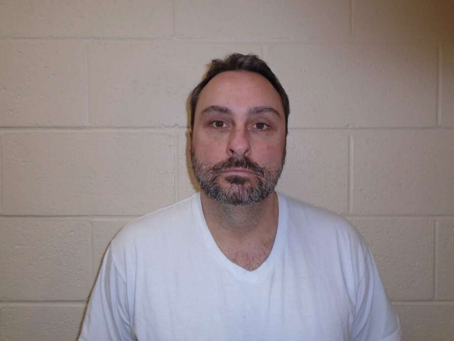 Michael Romano, 41, was charged Jan. 19, 2018, with several felonies after authorities  said he gave a 9-year-old girl an iPhone and instructed her to send him nude photos. Photo: Contributed Photo/ New Milford Police Department / Hearst Connecticut Media / Connecticut Post