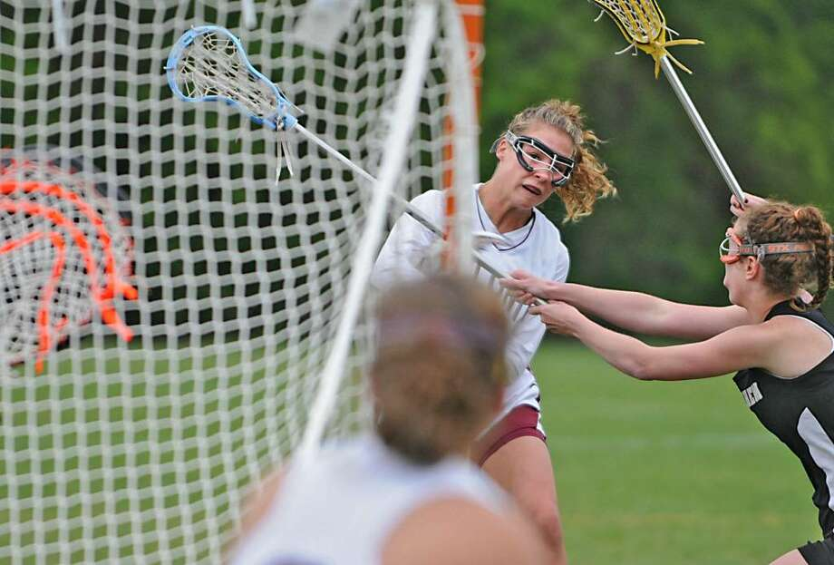 Colonie's Lexi Brannigan scores one of her three goals against Bethlehem. (Lori Van Buren / Times Union) Photo: LORI VAN BUREN