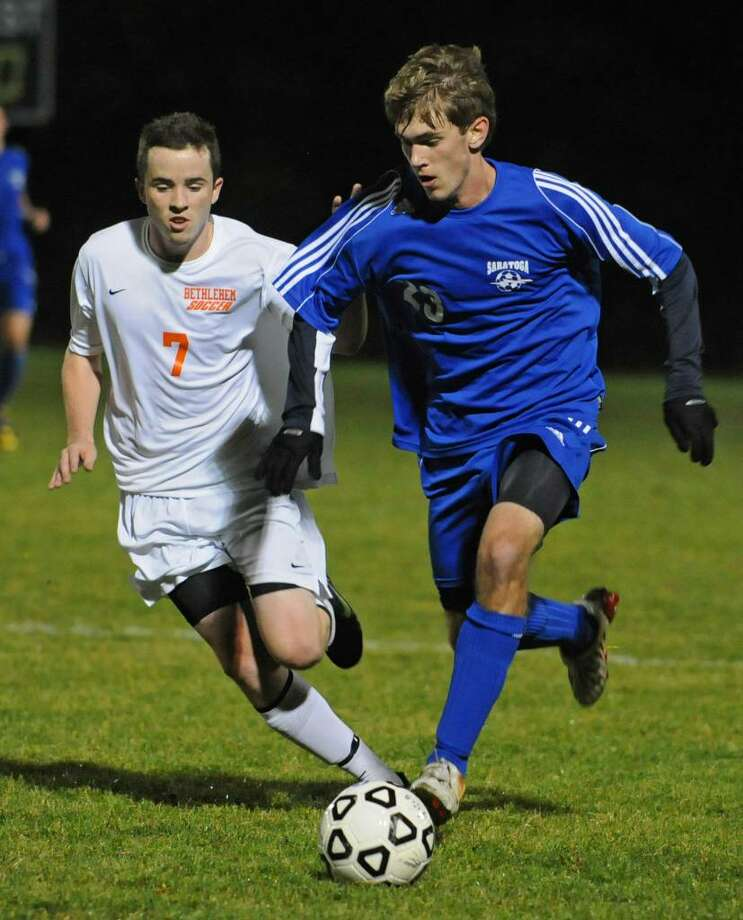 Mike Mulhall, left, of Bethlehem, and Tristan Frey of Saratoga battle for the ball during the Class AA boys' soccer semefinals held in Colonie .  (Lori Van Buren / Times Union) Photo: LORI VAN BUREN