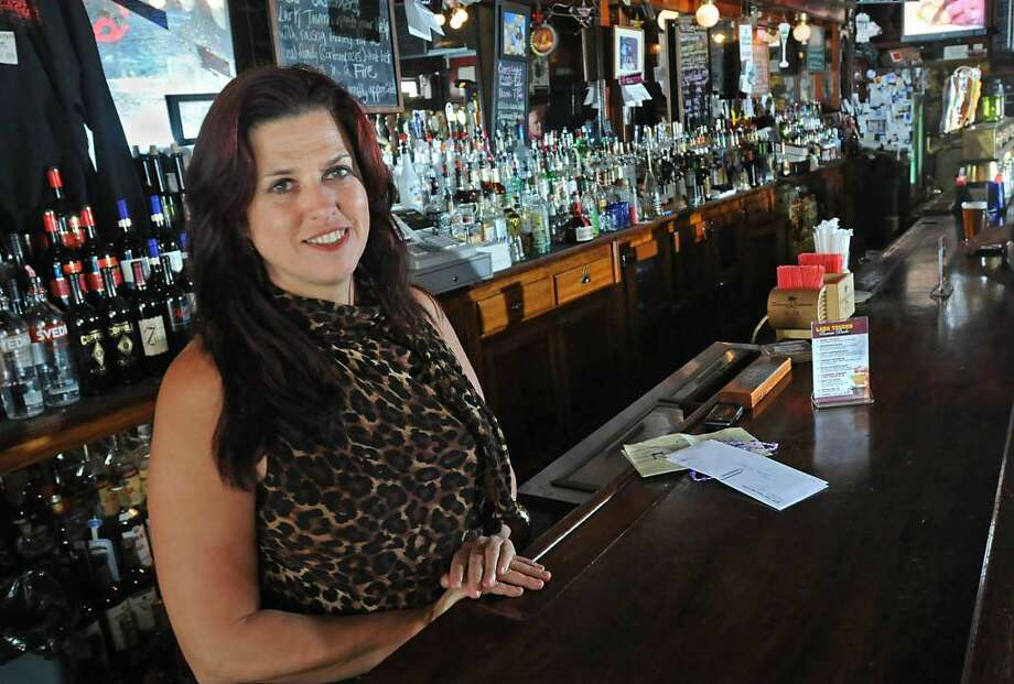 Tess Collins stands in her bar Tess' Lark Tavern in Albany, NY on August 31, 2009.  (Lori Van Buren / Times Union) Photo: LORI VAN BUREN / 00005292A