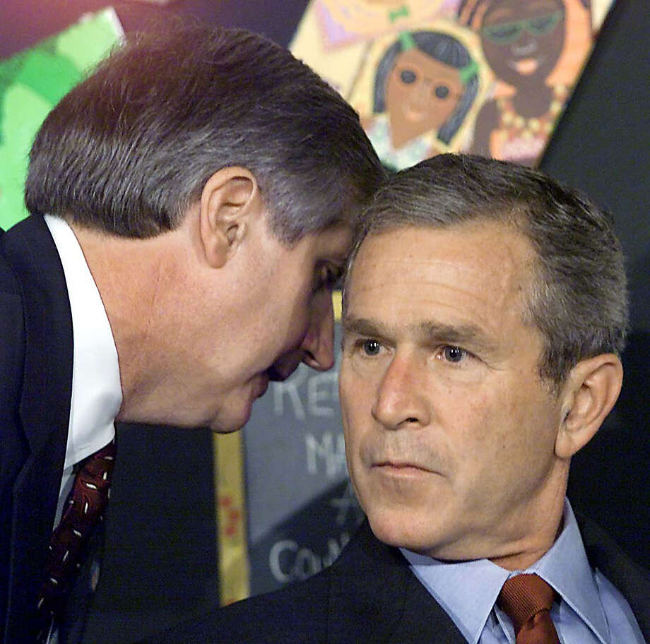 == With AFP Story by Lachlan CARMICHAEL: US-attacks-anniversary-diplomacy == (FILES): This September 11, 2001 file photo shows US President George W. Bush in Sarasota, Florida being told by White House Chief-of-Staff Andrew Card on the 9/11 terrorist attacks on US soil. Ten years later, analysts say, America has not fully recovered its standing as a steadfast defender of liberty and fierce protector of the rule of law, handing Osama bin Laden's Al-Qaeda at least a partial victory.     AFP Photo / Files / Paul J. RICHARDS (Photo credit should read PAUL J. RICHARDS/AFP/Getty Images) Photo: PAUL J. RICHARDS, Staff / AFP