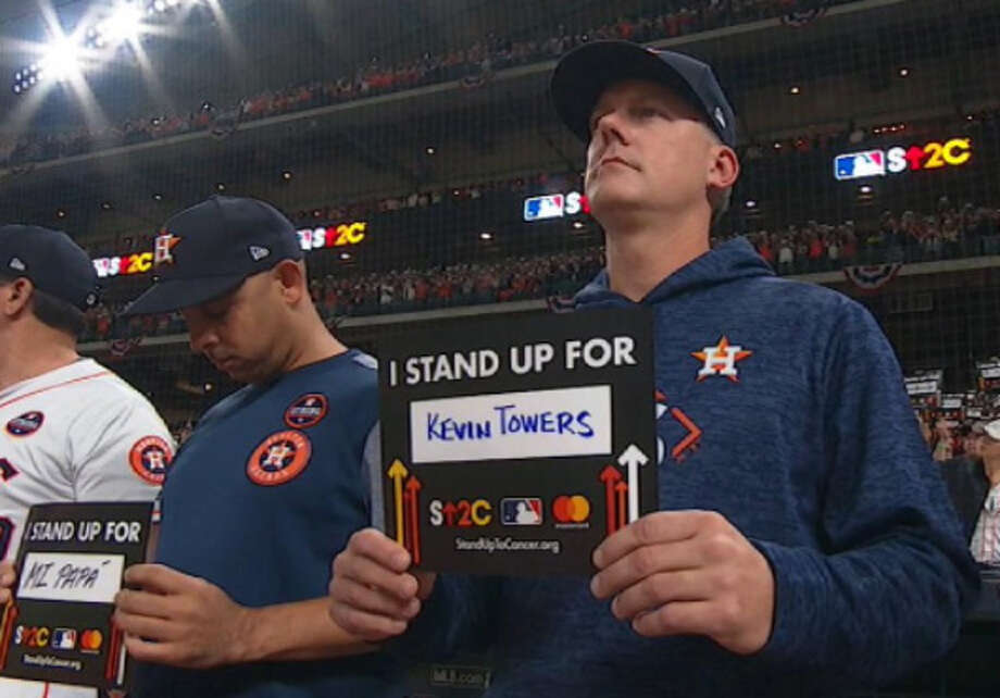 During Game 4 of the World Series at Minute Maid Park, players, coaches and fans held up signs as part of a Stand Up to Cancer campaign. Astros manager A.J. Hinch wrote the name of longtime Kevin Towers, who was battling cancer at the time. Photo: MLB