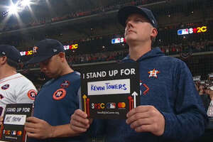 During Game 4 of the World Series at Minute Maid Park, players, coaches and fans held up signs as part of a Stand Up to Cancer campaign. Astros manager A.J. Hinch wrote the name of longtime Kevin Towers, who was battling cancer at the time.
