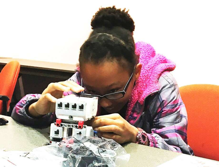 Victoria Carriere is one of the 12 participants of the Playbots Coding Club at the Tomball Community Library being offered to teach girls between the ages of 11 to 14 about robotics and computer coding. Photo: Photo Courtesy Of The Tomball Community Library