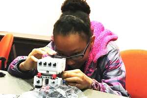 Victoria Carriere is one of the 12 participants of the Playbots Coding Club at the Tomball Community Library being offered to teach girls between the ages of 11 to 14 about robotics and computer coding.
