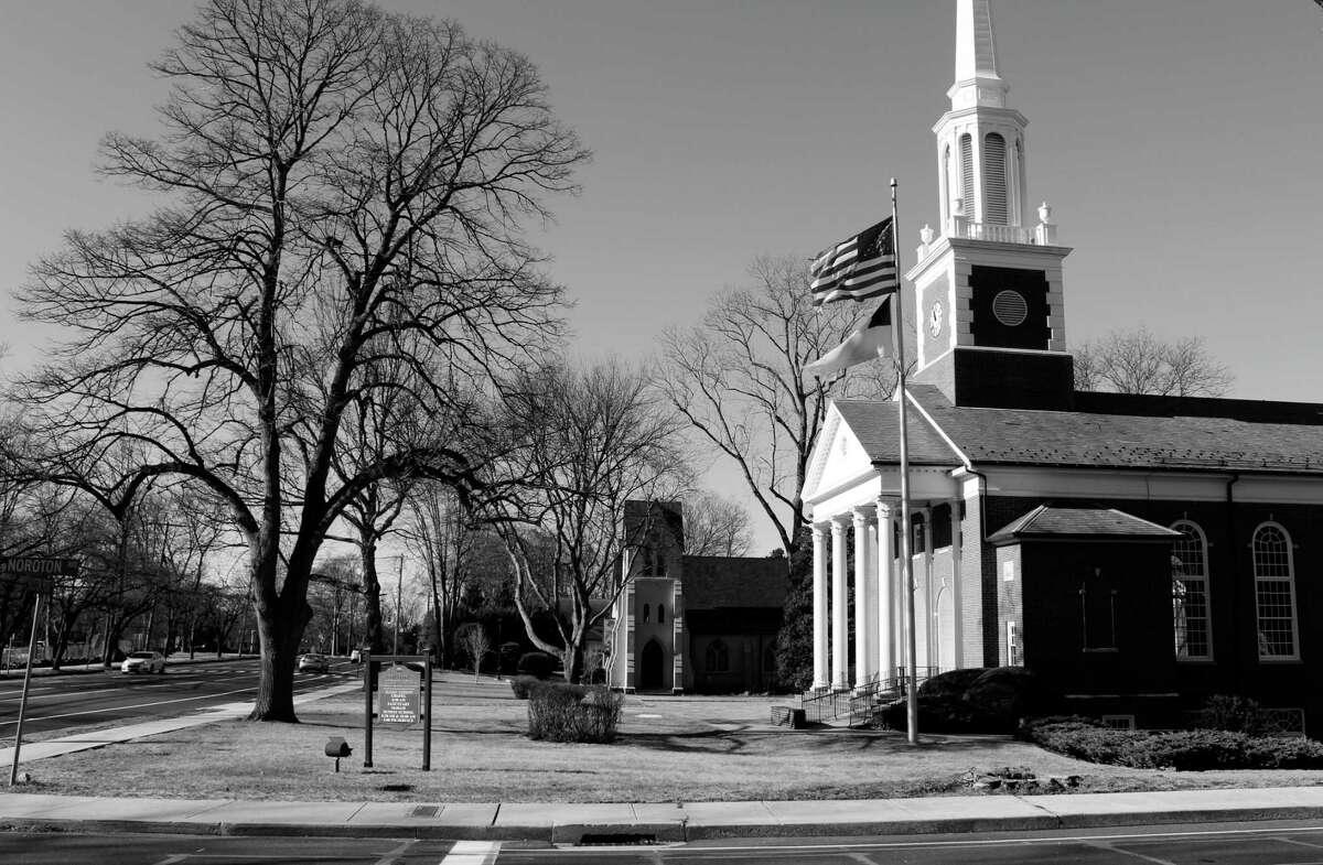 The wind blows a flag outside Noroton Presbyterian Church on Jan. 25, 2018 in Darien, Conn.