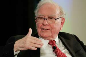 FILE - In this Oct. 3, 2017, file photo, investor Warren Buffett gestures on stage at a national conference sponsored by the Purpose Built Communities group that Buffett supports, in Omaha, Neb. Amazon, Buffett's Berkshire Hathaway and the New York bank JPMorgan Chase say they're creating a new company that will help address the health care needs of their U.S. workers, announced Tuesday, Jan. 30, 2018. (AP Photo/Nati Harnik, File)