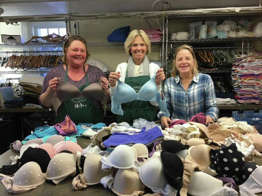 Volunteers at Neighbor to Neighbor, Greenwich, sort donations of bras received from Mardi Bra 2017. Photo: Contributed /