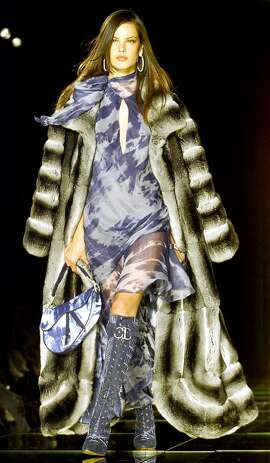 A model presents a long stripped fur coat, on a light cloud printed skirt, Tuesday, Feb. 29, 2000, during Christian Dior's fall-winter 2000-20001 ready to wear collection, by British fashion designer John Galliano, presented in Paris. (AP Photo/Michel Euler).