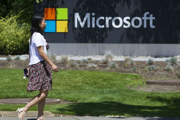 REDMOND, WASHINGTON - JULY 17: A pedestrian walks a sign on Microsoft Headquarters campus July 17, 2014 in Redmond, Washington. Microsoft CEO Satya Nadella announced, July 17, that Microsoft will cut 18,000 jobs, the largest layoff in the company's history. (Stephen Brashear/Getty Images)
