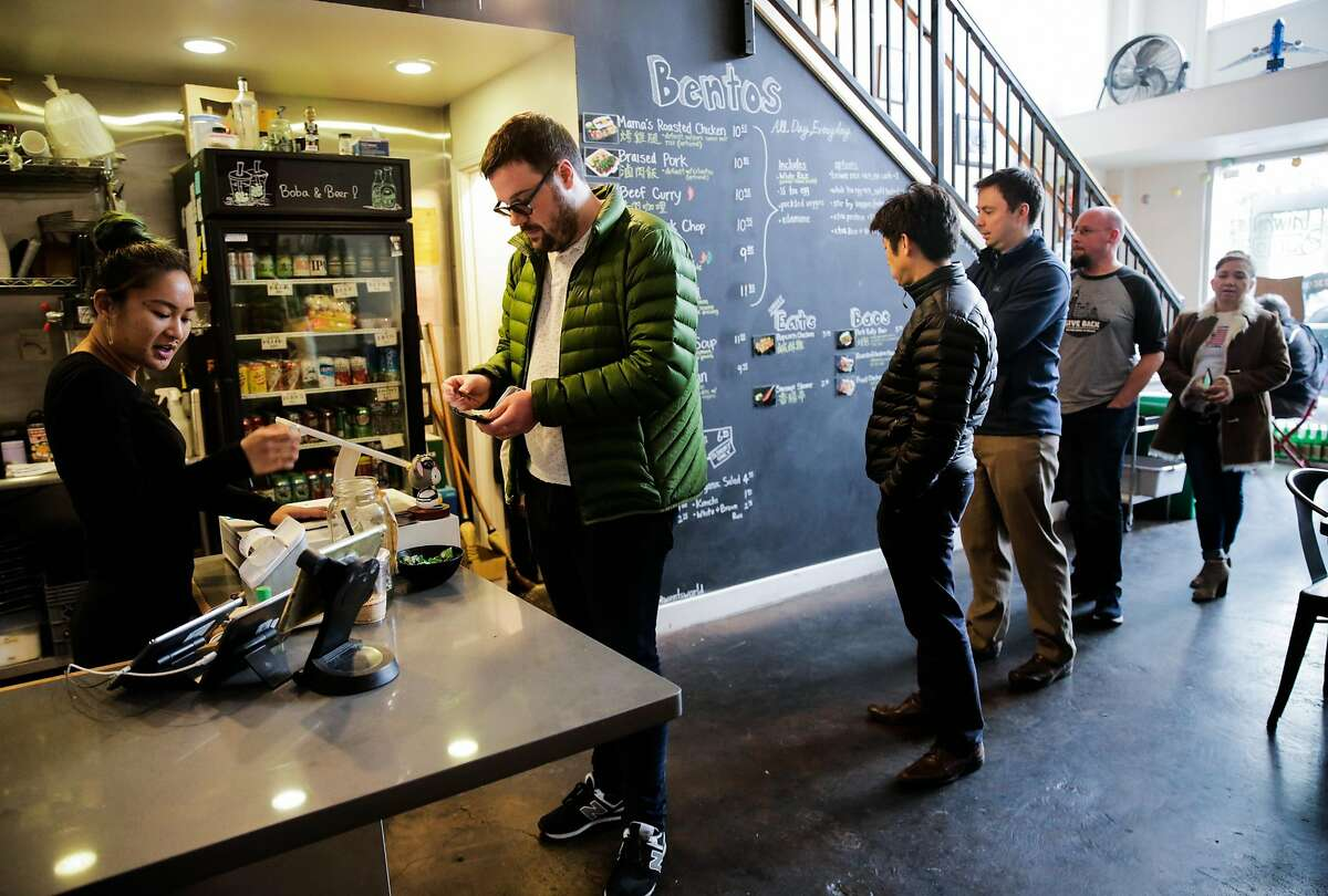 Customer Tom Sullivan (center) orders lunch at Taiwan Bento in Oakland, Calif., on Thursday, Jan. 4, 2018.