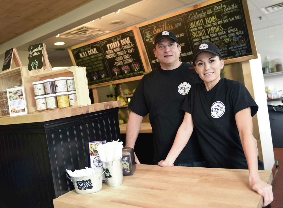 Co-owners Michael Stein and Shera Stein pose at SoBol in the Cos Cob section of Greenwich, Conn. Tuesday, Jan. 30, 2018. SoBol serves bowls and smoothies using the South American super fruit acai. The franchise has more than a dozen locations, mostly on Long Island, but the Cos Cob shop is the first in Connecticut.