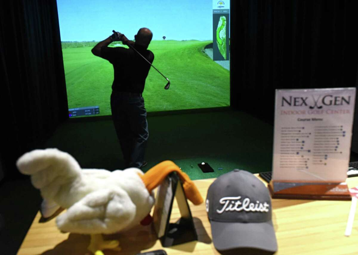 Gary Hanna of Troy plays a game of golf with a friend at NexGen Indoor Golf Center on Tuesday, Jan. 30, 2018 in Latham, N.Y. (Lori Van Buren/Times Union)