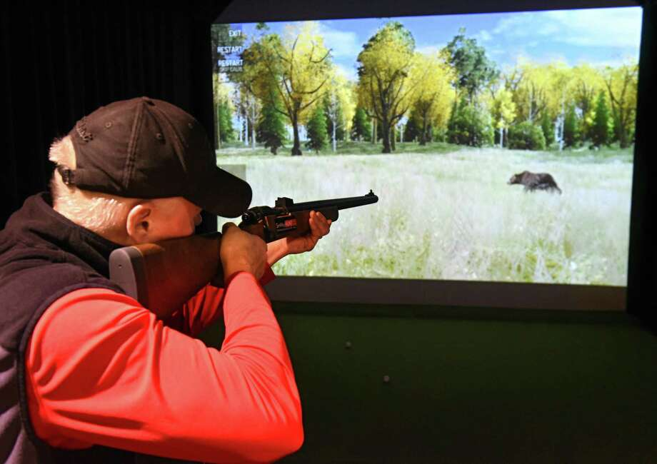 John Cooney of Wynantskill tries the new shooting range game at NexGen Indoor Golf Center on Tuesday, Jan. 30, 2018 in Latham, N.Y. (Lori Van Buren/Times Union) Photo: Lori Van Buren, Albany Times Union / 20042775A