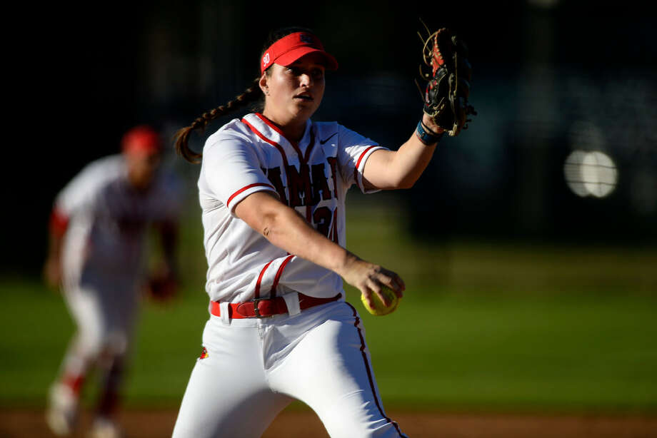Lamar softball pitcher Laura Napoli pitches in their home opener against Alabama A&M on Thursday afternoon. The Cardinals won 6-3.  Photo taken Thursday 2/23/17 Ryan Pelham/The Enterprise