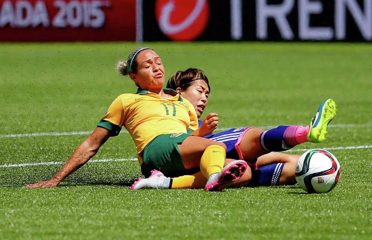 Kyah Simon #17 of Australia challenges Azusa Iwashimizu #3 of Japan for the ball during the FIFA Women's World Cup Canada 2015 Quarter Final match between Australia and Japan at Commonwealth Stadium on June 27, 2015 in Edmonton, Canada.