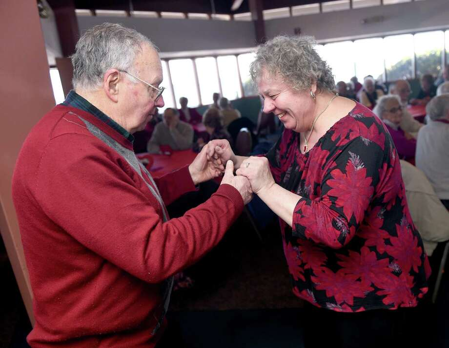 (Arnold Gold-New Haven Register)  Roger and Alma Loiseau dance to the music of The Clamdiggers at the 25th Annual Valentine's Day party for West Haven couples married at least 50 years at the Savin Rock Conference Center in West Haven on 2/13/2015.  The Loiseaus have been married for 52 years.