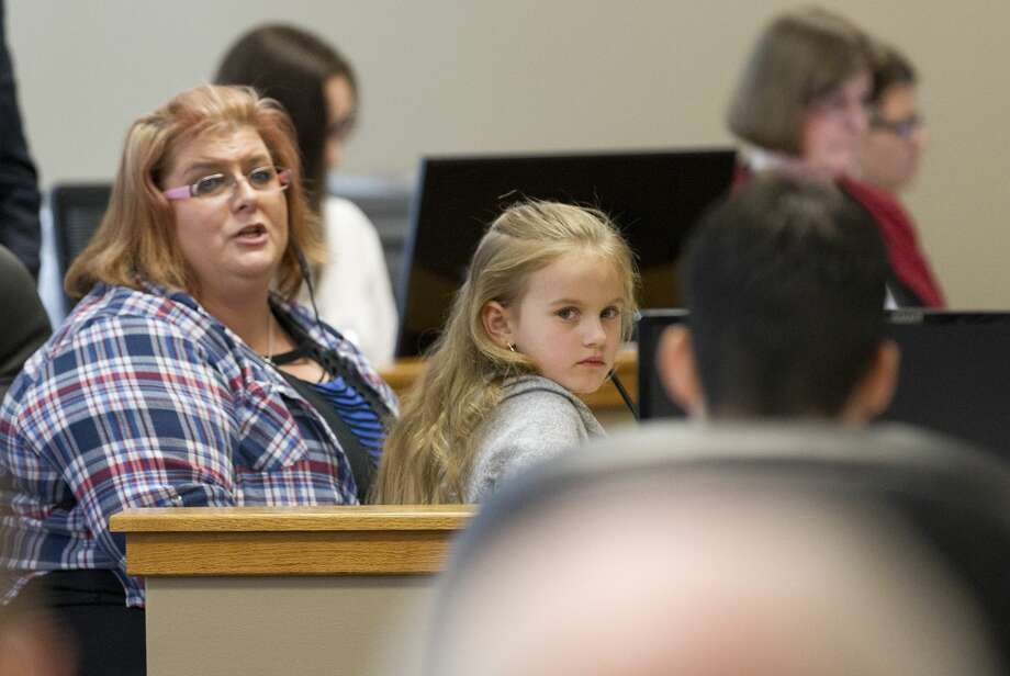 Chloe Baumgartner, 6, looks at Kingwood's Garrett Nee as her mother Donna delivers a victim impact statement in the 9th state District Court at the Lee G. Alworth Building, Tuesday, Jan. 30, 2018, in Conroe. Nee was sentenced to 15 years for the 2016 death of Stacey Baumgartner and 11-year-old Adan Hilario, Jr. in a Father's Day crash that followed a police chase. Photo: Jason Fochtman/Houston Chronicle