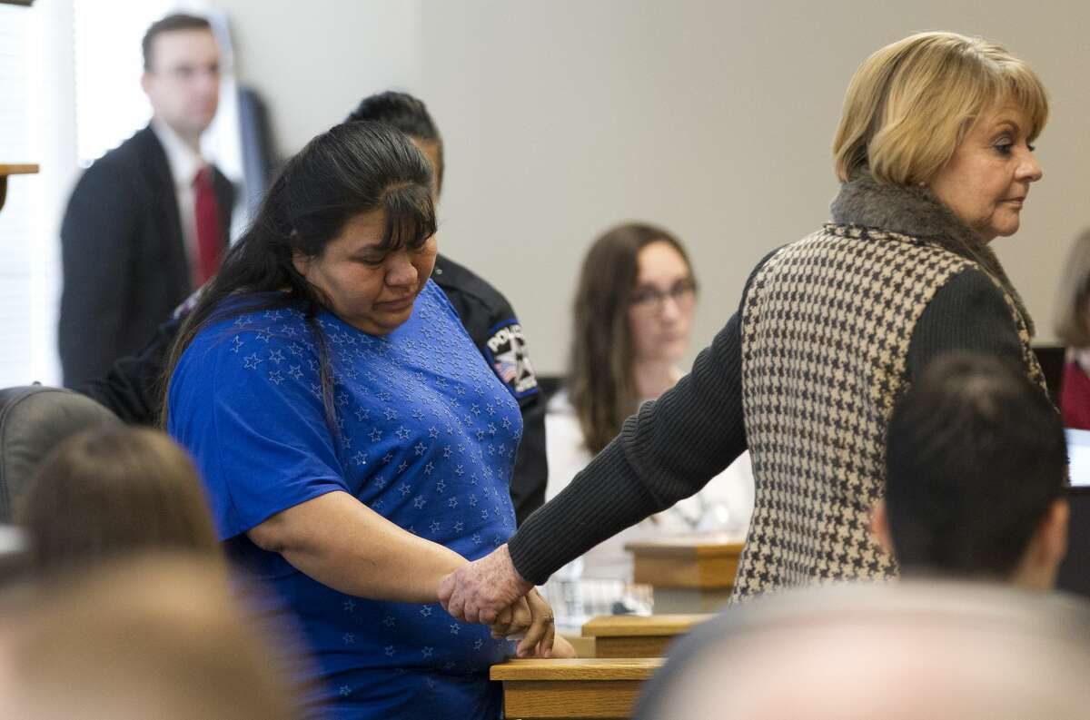 Chloe Baumgartner, 6, gives a kiss to her mother Donna, wife of Patton Village Police Sgt. Stacey Baumgartner, during the trial of Kingwood's Garrett Nee in the 9th state District Court at the Lee G. Alworth Building, Tuesday, Jan. 30, 2018, in Conroe. Nee was sentenced to 15 years for the 2016 death of Patton Village Police Sgt. Stacey Baumgartner and 11-year-old Adan Hilario, Jr. in a Father's Day crash that followed a police chase.