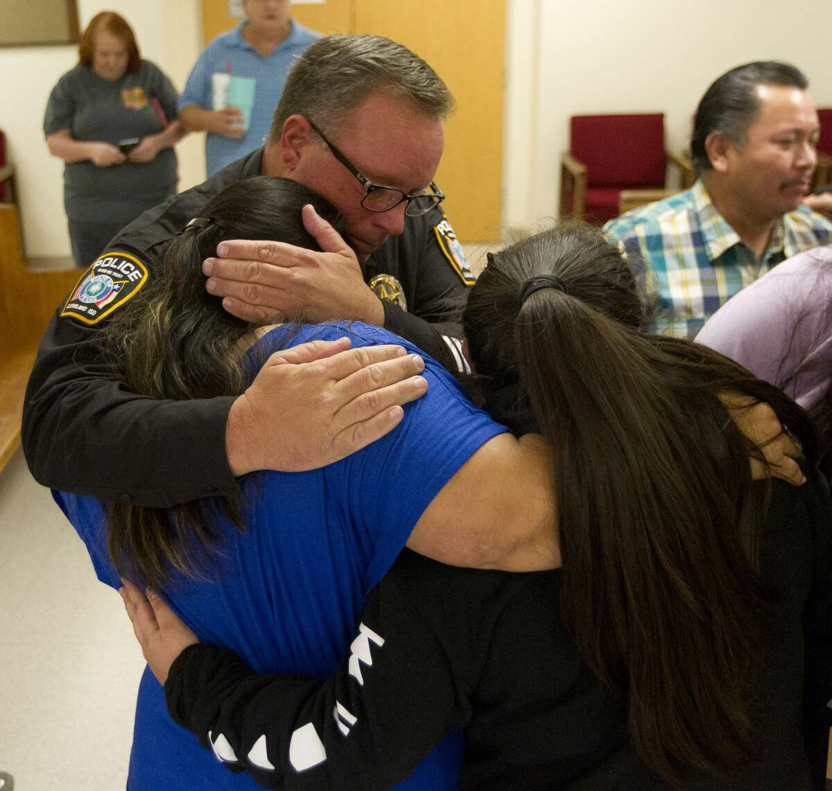 Cleveland ISD Police Chief Rex Evans hugs the family of 11-year-old Adan Hilario, Jr. after Kingwood's Garrett Nee was sentenced to 15 years for the 2016 death of Hilario, Jr. and Patton Village Police Sgt. Stacey Baumgartner in a Father's Day crash that followed a police chase.
