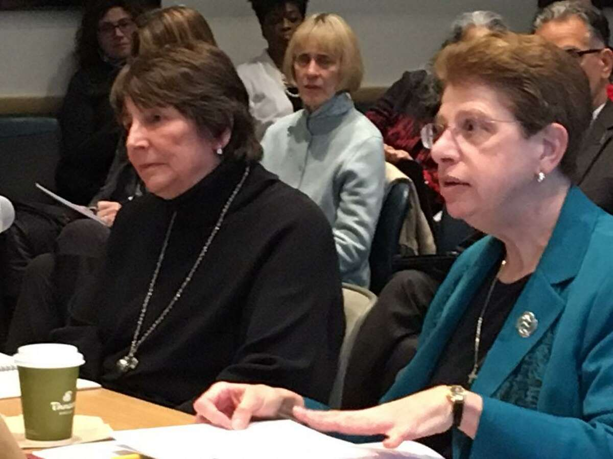 New England Association of Schools and Colleges officials meet with the Connecticut Board of Regents on Jan. 11 to discuss the proposed merger of the state's community colleges