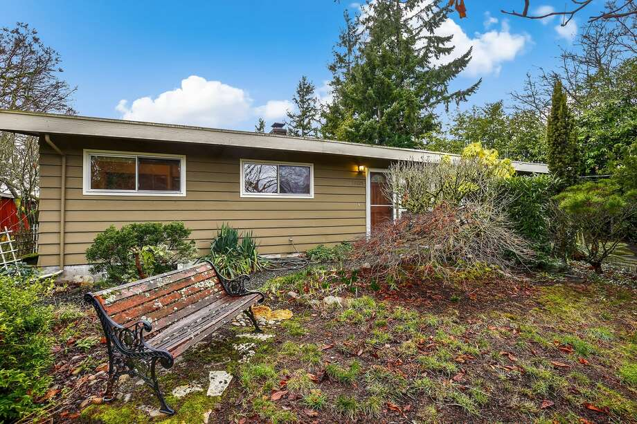 This lovely mid-century sits on an oversized, private lot surrounded by greenery. Upstairs are newly exposed original hardwoods in this three-bedroom, and the kitchen provides access to the backyard. Head downstairs for loads of potential and a separate entrance.11025 21st Ave. S.W., listed for $440,000. See the full listing below. Photo: Listing Provided Courtesy Of Julie Granahan, Redfin Corp.