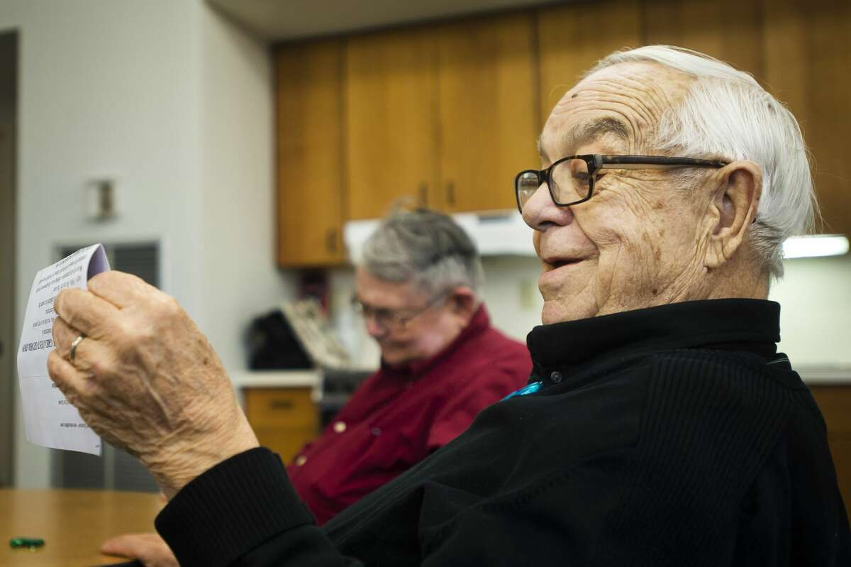 Buck Last, 84, reads a short story he wrote to a writer's group during their weekly gathering at Riverside Place Senior Living Community on Tuesday, Jan. 30, 2018. Each member of the group gets a turn to share a story, whether it is written or from memory. (Katy Kildee/kkildee@mdn.net)