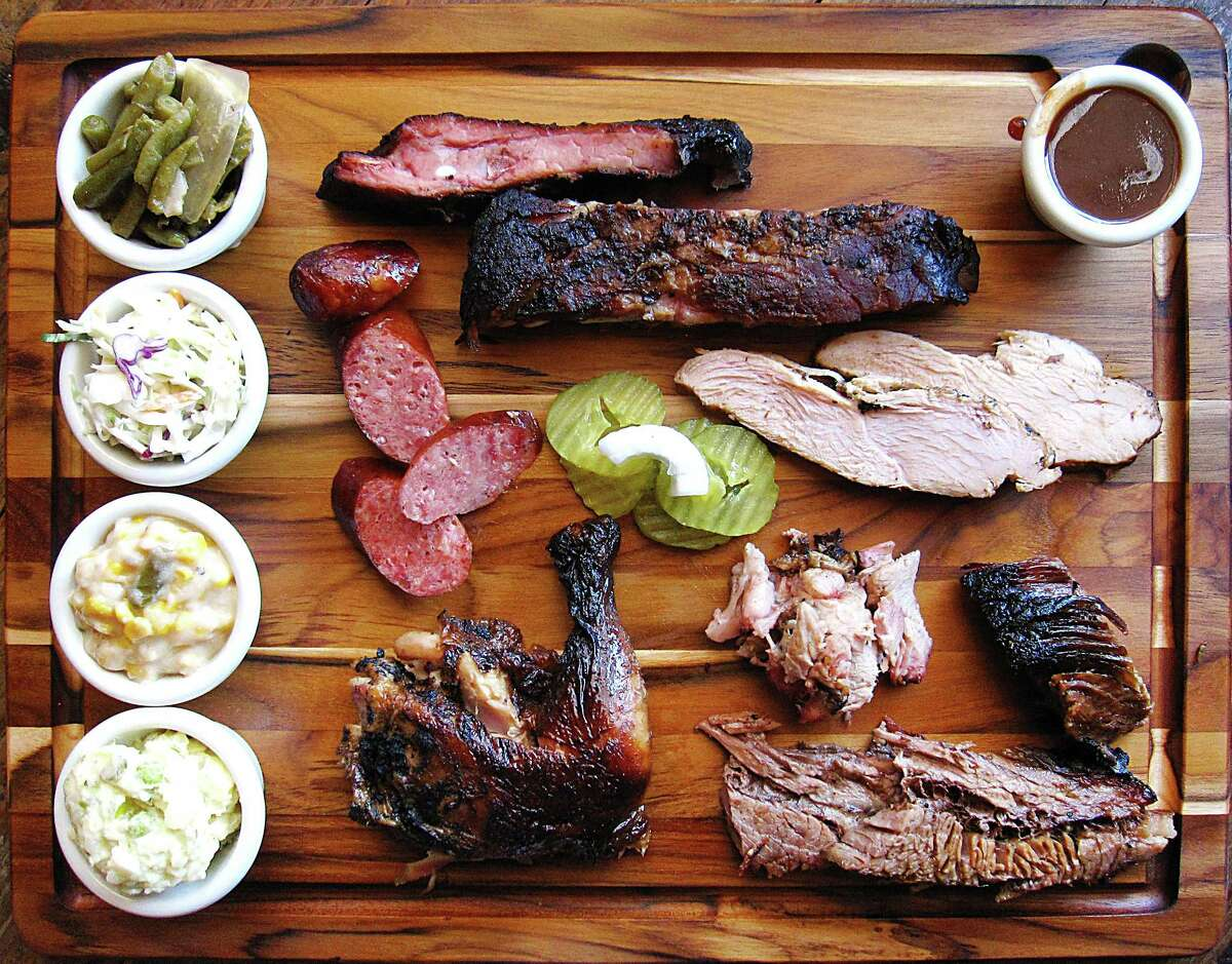 Meat and sides from Harmon's Barbecue in Cibolo. Clockwise from bottom left: potato salad, creamed corn, cole slaw, green beans, pork spare ribs, barbecue sauce, turkey, brisket, pork, chicken and sausage.