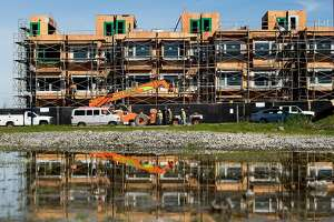 Construction workers build new housing at the former Hunters Point Naval Shipyard on Tuesday, Jan. 30, 2018, in San Francisco.