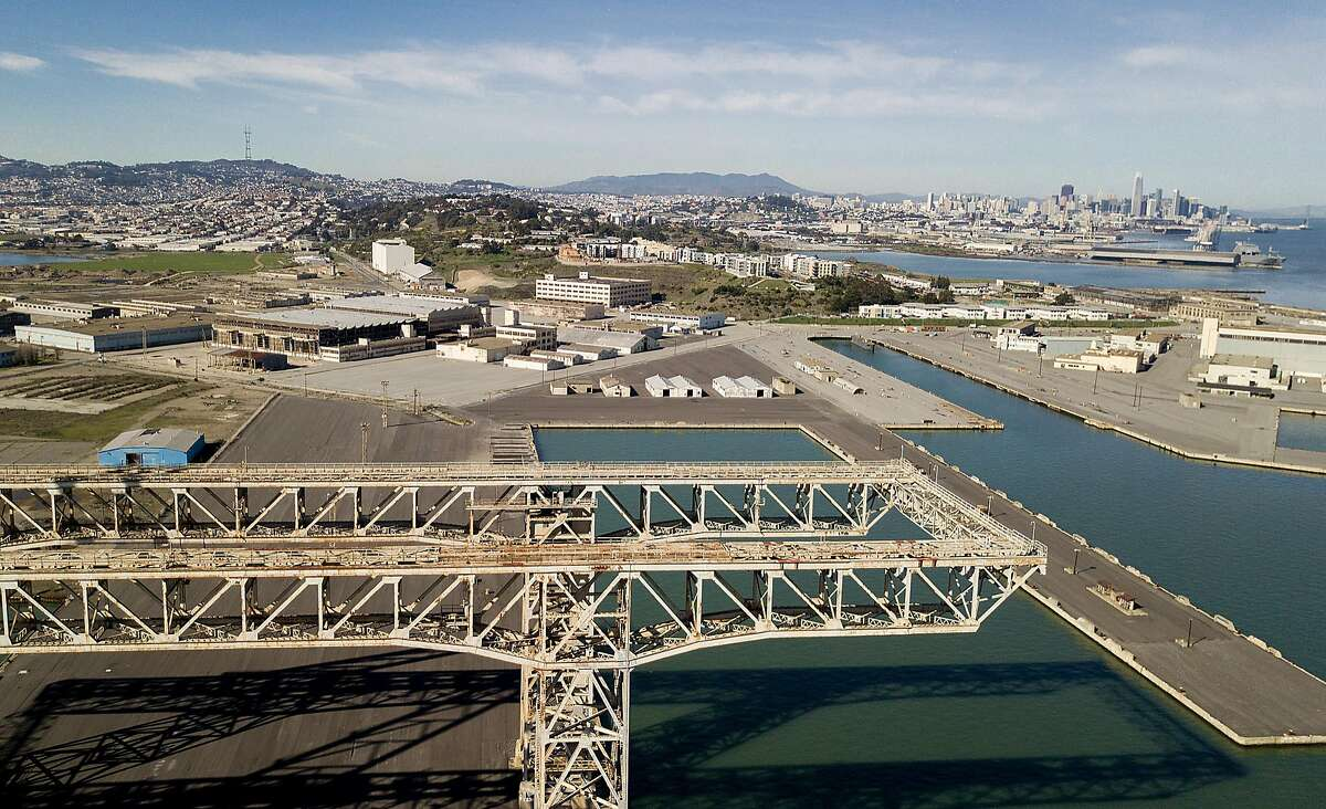 Parcel G is pictured behind cranes at the former Hunters Point Naval Shipyard on Tuesday, Jan. 30, 2018, in San Francisco.