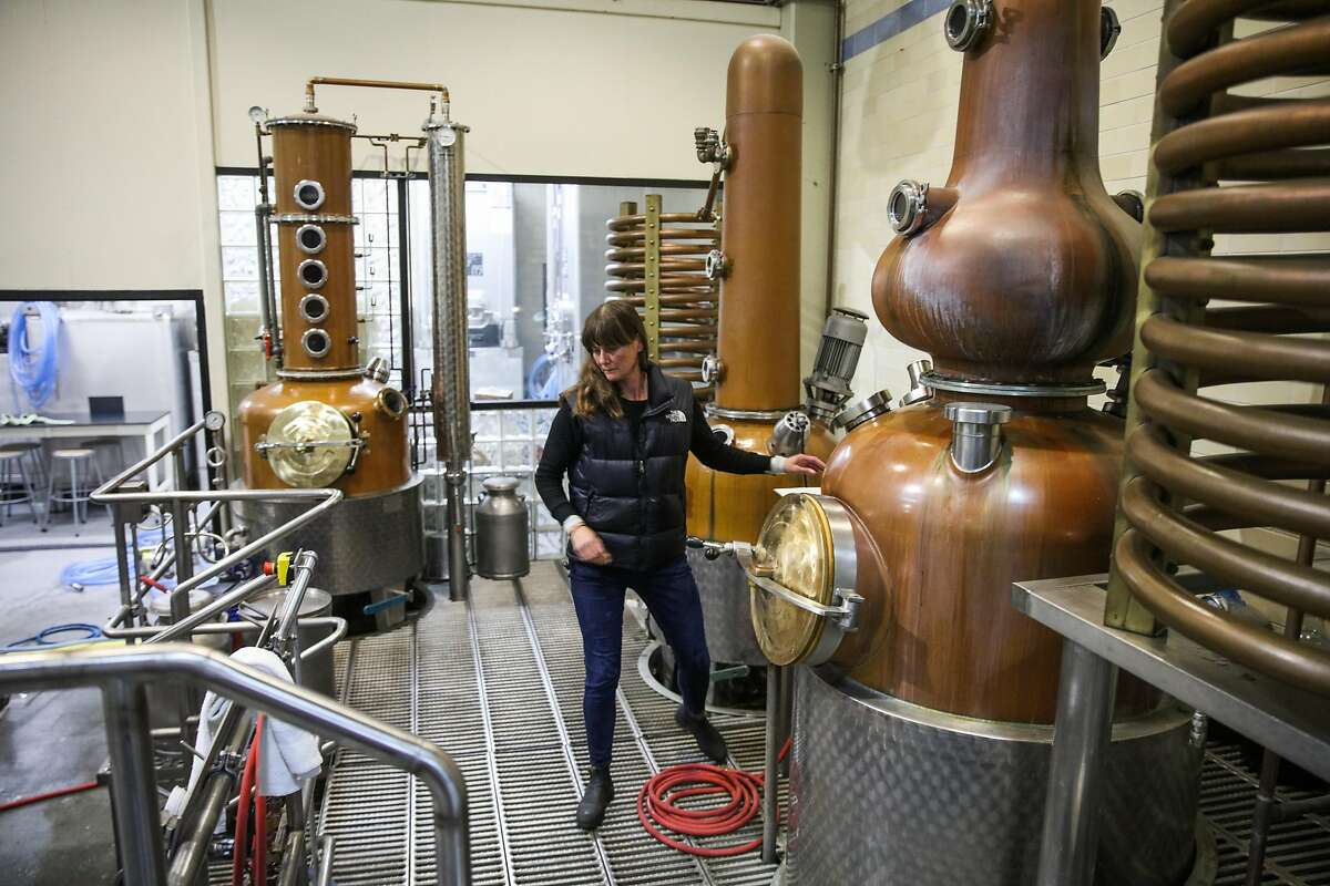 Lead distiller Kendra Scott works in the production area at Anchor Distilling in San Francisco, California, on Monday, Jan. 29, 2018.