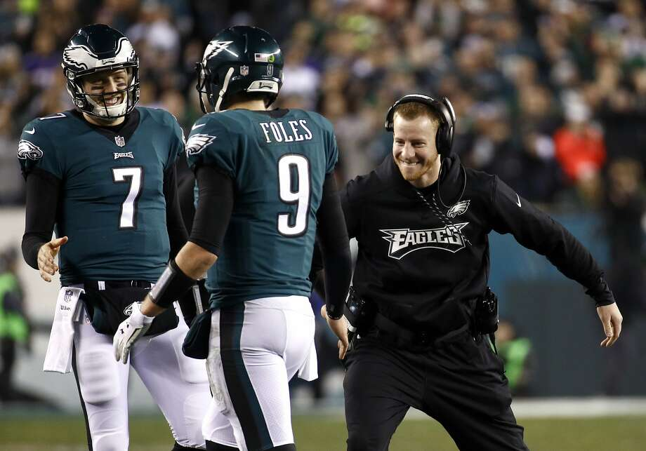 FILE - In this Sunday, Jan. 21, 2018, file photo, Philadelphia Eagles' Carson Wentz, right,  congratulates Nick Foles (9) during the second half of the NFL football NFC championship game against the Minnesota Vikings in Philadelphia. Wentz, who is injured, watched both playoff games from the sideline, rooting hard for his teammates and enjoying their success without him. He'll be their No. 1 fan Sunday when they take on the New England Patriots and try to win the franchise's first NFL title since 1960. (AP Photo/Patrick Semansky, File) Photo: Patrick Semansky, Associated Press