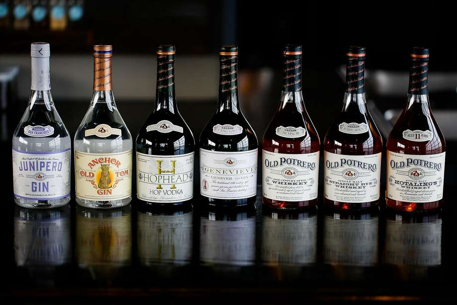 A lineup of Junipero Gin, Old Tom Gin, Hophead Vodka,Genevieve Whiskey, Old Potrero 18th Century-style Whiskey, Old Potrero Rye Whiskey and Old Potrero Hotalings Whiskey is seen at Anchor Distilling in San Francisco. Photo: Gabrielle Lurie, The Chronicle