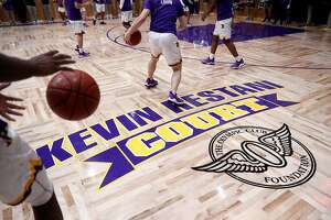 Archbishop Riordan High School basketball team warms up before playing St. Ignatius on the soon to be dedicated Restani Court, honoring Kevin Restani, a 1970 Riordan graduate who starred at USF and in the NBA. Photographed in San Francisco, Calif., on Tuesday, January 23, 2018.