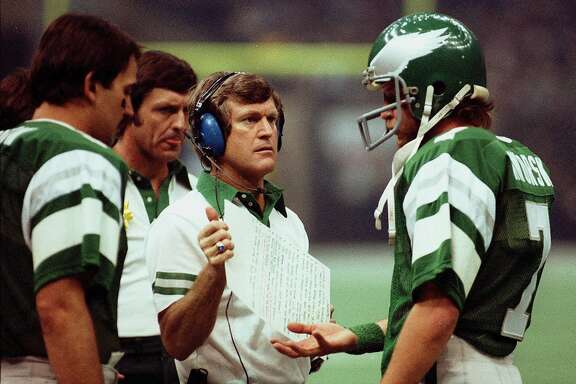 FILE--Philadelphia Eagles head coach Dick Vermeil, center, talks to quarterback Ron Jaworski on the sidelines during a game in this 1981 file photo from Philadelphia. (AP Photo/file)