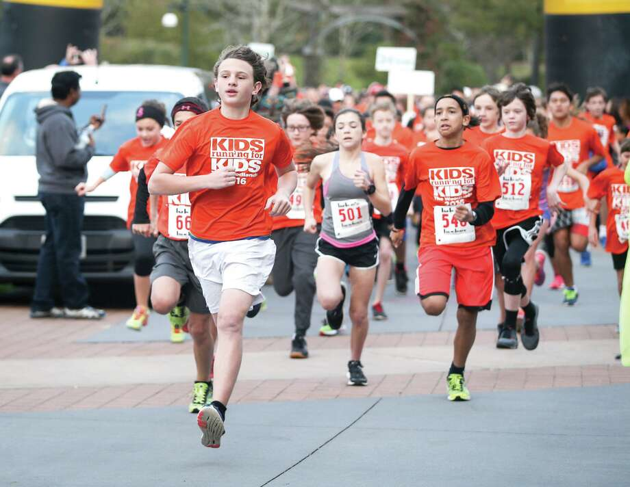 Children take off from the starting line during the Kids Running For Kids event on Saturday, Feb. 13, 2016, at Town Green Park. Photo: Michael Minasi, Photographer / Conroe Courier