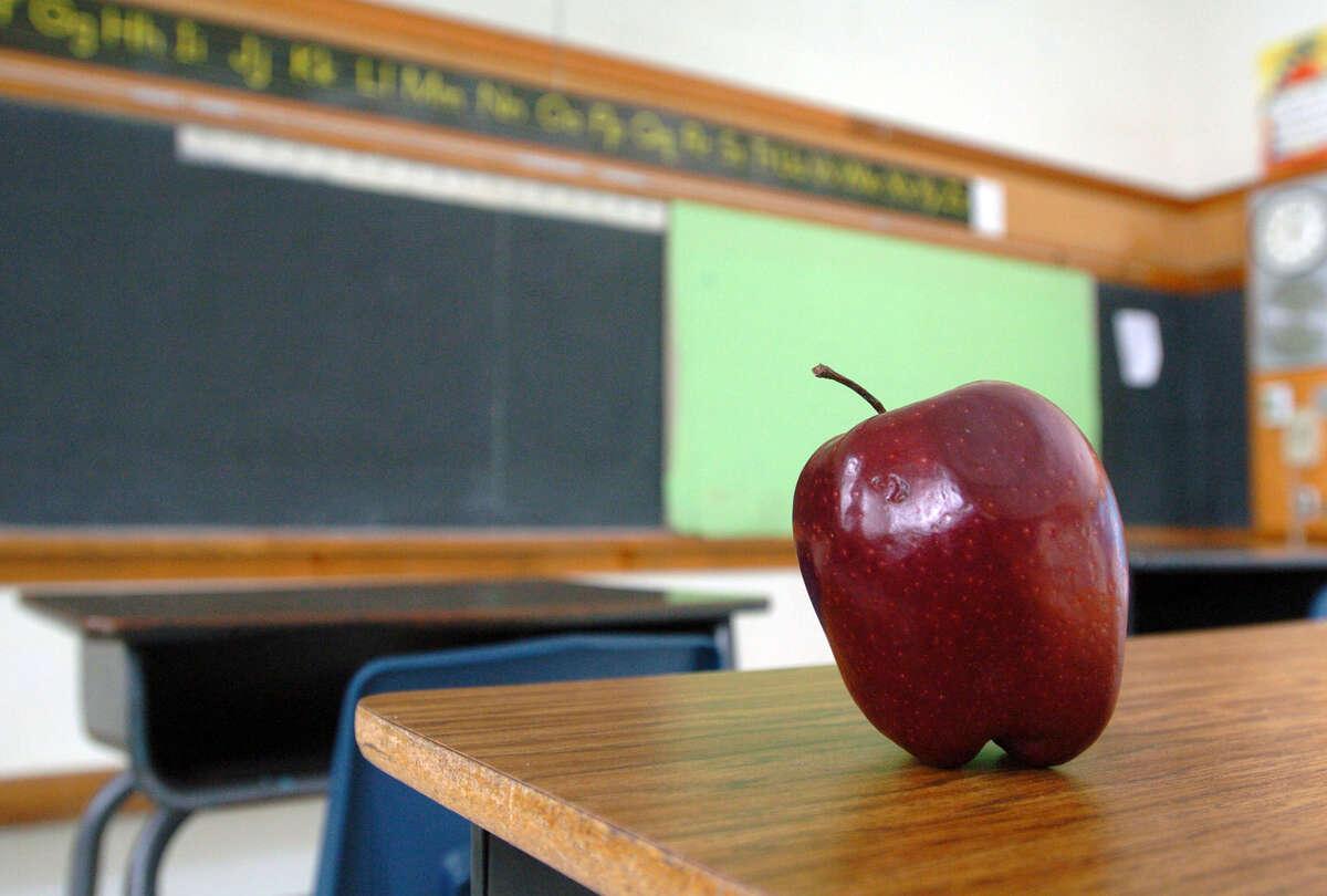An empty classroom photo illustration.