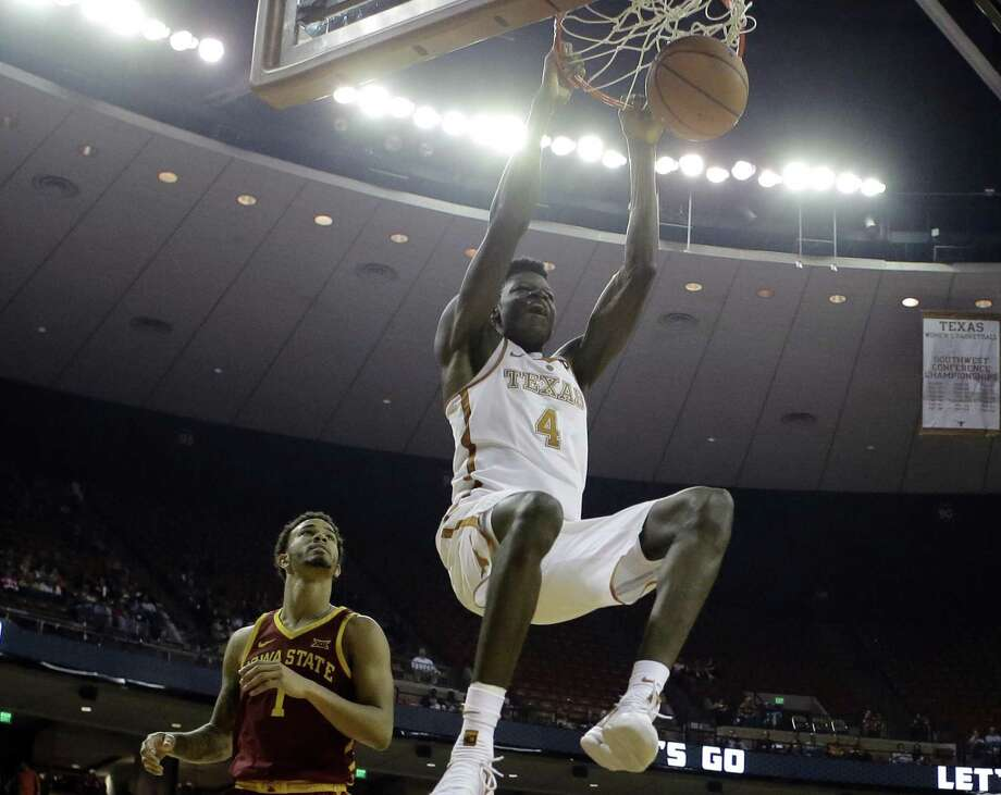Texas forward Mohamed Bamba (4) scores as Iowa State guard Nick Weiler-Babb (1) and forward Solomon Young (33) looks on during the second half of an NCAA college basketball game, Monday, Jan. 22, 2018, in Austin, Texas. Texas won 73-57. (AP Photo/Eric Gay) Photo: Eric Gay, STF / Associated Press / Copyright 2018 The Associated Press. All rights reserved.