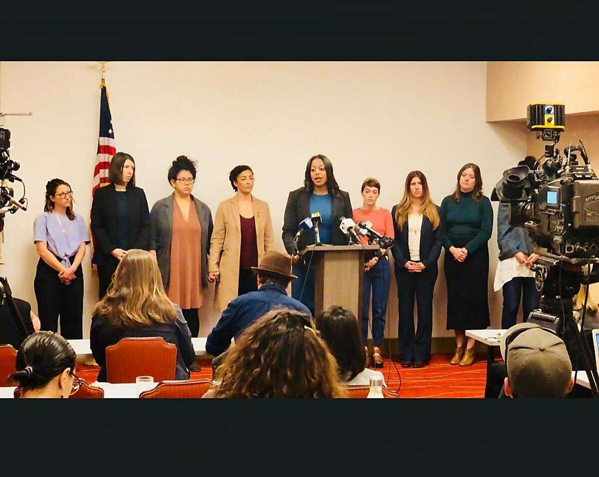 Nine former employees of Oakland chef Charlie Hallowell and attorney Mika Hilaire (center) held a press conference on Tuesday, Jan. 30 in Oakland, calling on Hallowell to divest completely from his restaurants in the wake of allegations of his serial sexual harassment.