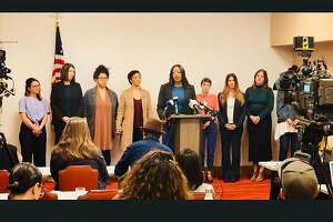 Nine former employees of Oakland chef Charlie Hallowell and attorney Mika Hilaire (center) held a press conference on Tuesday, Jan. 30, 2018 in Oakland, calling on Hallowell to divest completely from his restaurants in the wake of allegations of his serial sexual harassment.