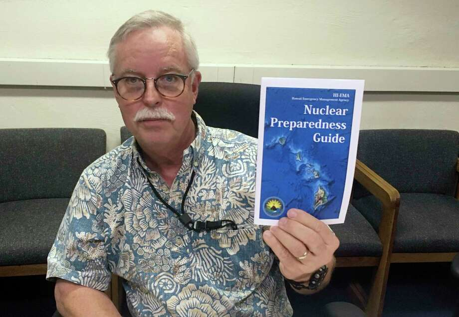 Hawaii Emergency Management Agency official Toby Clairmont shows a new nuclear guide. Administrator Vern Miyagi resigned after the recent alert fiasco.  Photo: Jennifer Sinco Kelleher, STF / AP