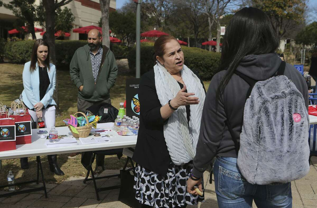 Carmen De Luna-Jones (center,facing) speaks to student Bella Avila (right, facing away) Tuesday January 30, 2018 during an information session held at San Antonio College for undocumented students. Faculty and advisors were on hand to provide information about scholarships, legal services and more. De Luna-Jones is an offsite coordinator for Alamo Colleges.