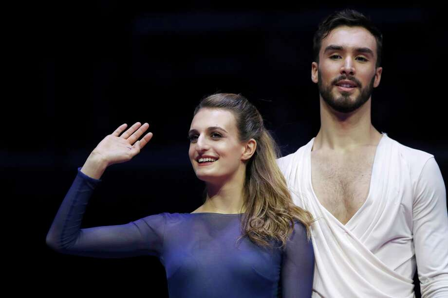 FILE - In a Saturday, Jan. 20, 2018 file photo, France's Gabriella Papadakis and Guillaume Cizeron greet spectators after winning the pairs ice dance free dance event at the European figure skating championships in Moscow, Russia. One of the oddities of figure skating is that training partners are often your biggest rivals.  (AP Photo/Pavel Golovkin, File) Photo: Pavel Golovkin, STF / Copyright 2018 The Associated Press. All rights reserved.