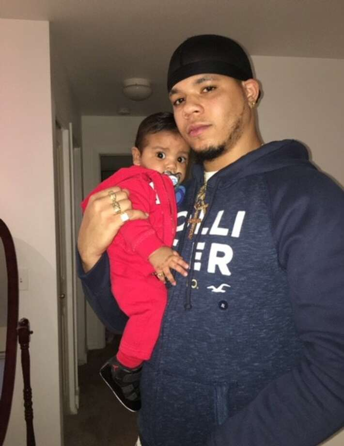 Dashawn Horne, pictured with his 16-month-old child, was beaten unconscious with a baseball bat in Auburn Jan. 20. He remains in Harborview Medical Center's intensive care unit. The alleged attacker is charged with first-degree assault and malicious harassment, the state's hate crime law. Photo: Courtesy Of Vanessa Zuniga