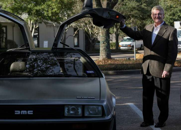 Roger Dartt, president of the DeLorean Motor Company, poses for a photograph with his DeLorean outside the Ouisie's Table restaurant Tuesday, Jan. 30, 2018, in Houston. ( Godofredo A. Vasquez / Houston Chronicle )