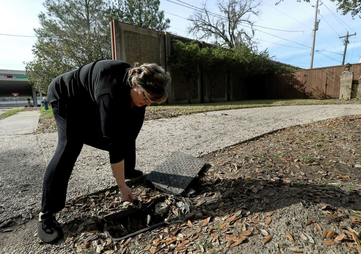 Trish Hagner got a $1,049 water bill in September after rescue equipment broke her water meter during Hurricane Harvey. Ruts in her yard are still visible five months after the storm.